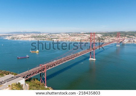 25th of April Suspension Bridge over the Tagus river in Lisbon, Portugal - stock photo