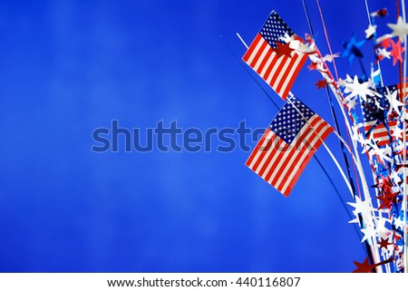 4th of July American Independence Day decorations on blue background - stock photo