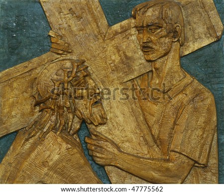 5th Station of the Cross - Simon of Cyrene carries the cross - stock photo