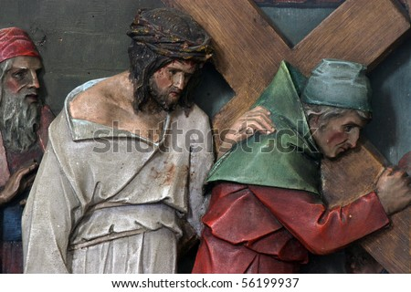 5th Stations of the Cross, Simon of Cyrene carries the cross - stock photo