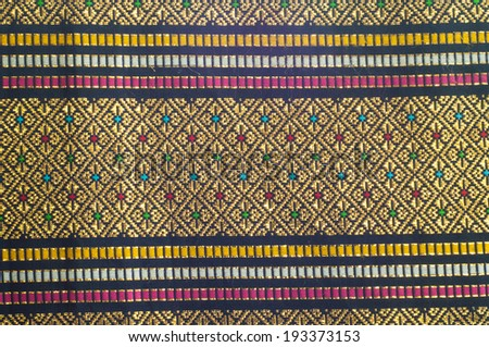 Thai fabric gold silk textile pattern - stock photo