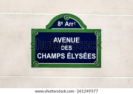 The Avenue des Champs Elysees street sign,  situated in the 8th arrondissement of Paris, France. One of the most famous streets in the world. - stock photo