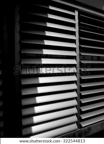 the black and white of window shutters - stock photo