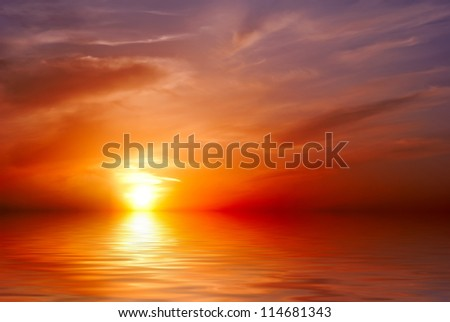 """""""The blood-red"""" sunset on the background of the sea - stock photo"""