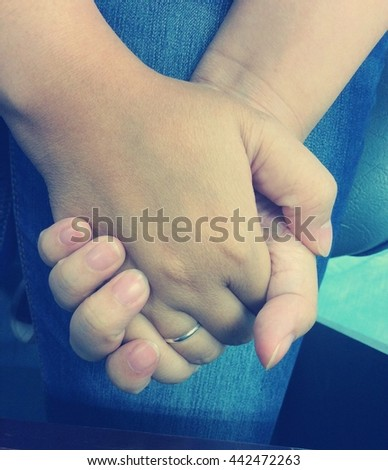 The close up shot of couple hand holding together in vintage concept of love, care, encourage and relationship - stock photo