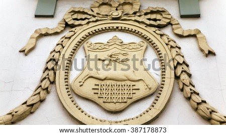the emblem of the city of Grodno on the wall of an old building. Grodno, Belarus - stock photo