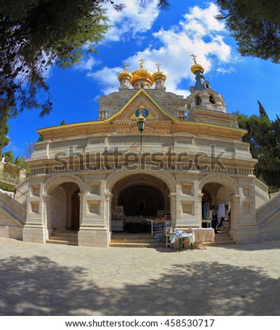 The facade of the church of St. Mary Magdalene white marble.  Above the triangular portico golden domes topped with golden crosses. Mount of Olives in Jerusalem - stock photo