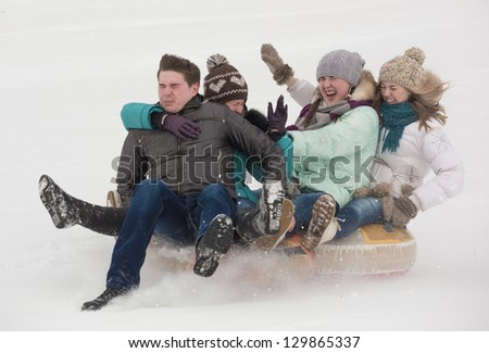 The group of youth moves down from mountain - stock photo