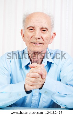the hands of elderly man are crossed - stock photo