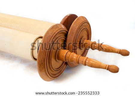 The Hebrew handwritten Torah, on a synagogue alter, illustrating Jewish holidays, during fests. Closed version with wooden handles.  - stock photo