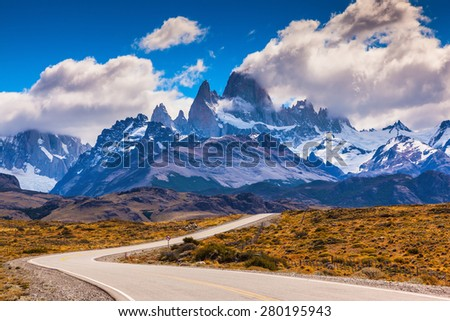 The highway crosses Patagonia and leads to majestic mountains of Fitzroy. The road through desert - stock photo