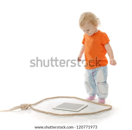 The kid faces to a rope loop in which computer - stock photo