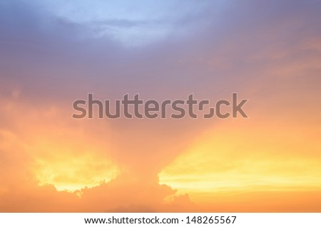 The light shines through the clouds - stock photo