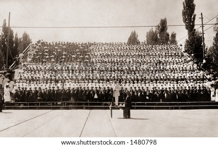 ''The Living Flag'' - about 1350 children dressed to illustrate 13 red and white stripes, and a blue field (holding white stars) -  a circa 1915 vintage photograph - stock photo