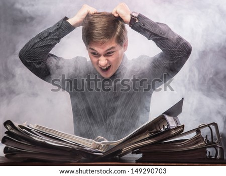The man in horror looks documents - stock photo