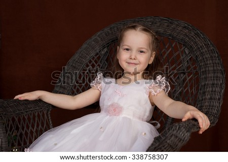 the nice girl on a brown background  - stock photo