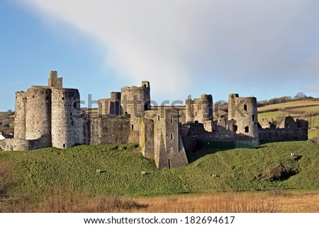 The Norman fortress at Kidwelly overlooking the River Gwendraeth. The castle dates from around AD1200 and featured in the Welsh Marches - stock photo