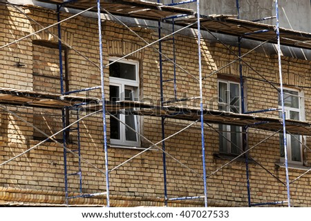 the old building during its restoration and recovery, close up - stock photo