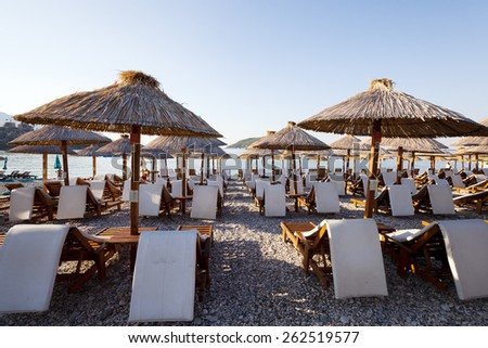 the photographed wooden umbrellas located in the territory of a beach - stock photo
