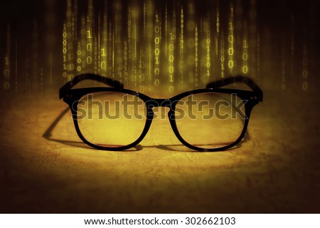 the reading eyeglasses absorb binary data , concept of future knowledge technology vision - stock photo