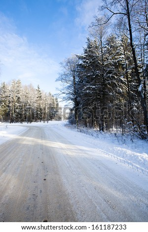 the road in a winter season. the road is covered with snow - stock photo
