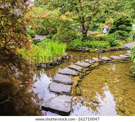 The track of the stones in the Japanese part of the garden. Amazingly beautiful decorative private garden in western Canada Butchart Gardens - stock photo