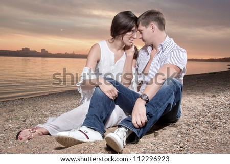 The woman and the man have rested foreheads - stock photo