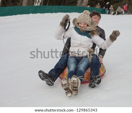 The young pair moves down from a hill - stock photo