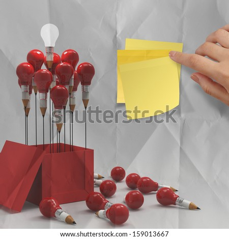 thinking outside the box on sticky note and pencil lightbulb as creative on crumpled paper - stock photo
