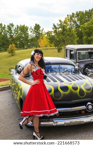"""THORNCLIFF CALGARY CANADA, SEPT 13 2014: The annual Show and Shine with Pin Up Girls  """"Cars before 1964""""   - stock photo"""