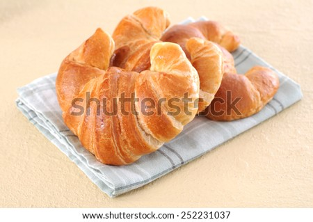 three  delicious croissants on table for breakfast  - stock photo