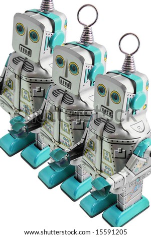 three retro toy  robots - stock photo