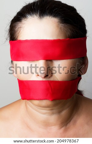 Tied mouth and blindfold eyes.Censored and freedom of speech - stock photo
