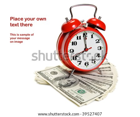 """Time is money"" concept - classic alarm clock over dollars - stock photo"
