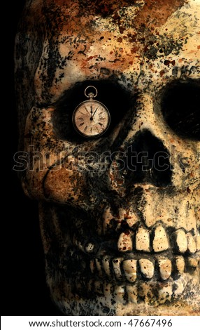 time's running out - skull with fob style watch in eye socket - stock photo