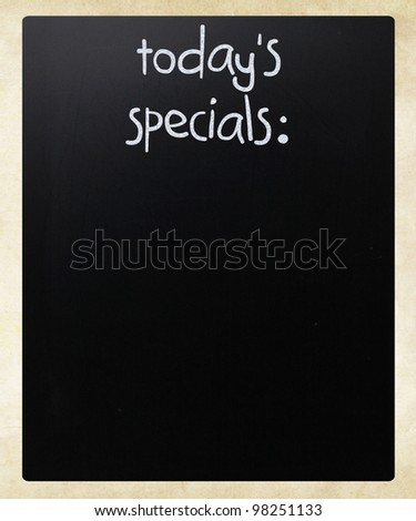 """Today's specials"" handwritten with white chalk on a blackboard - stock photo"
