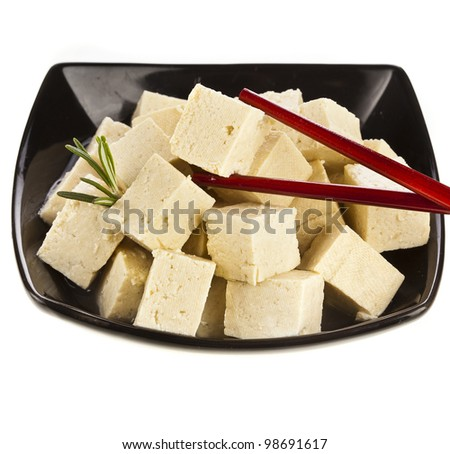 Tofu cubes  on plate isolated on white - stock photo