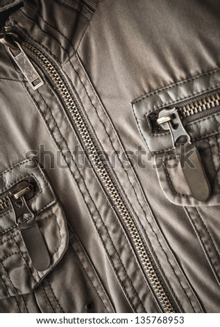 toned jacket fragment with metal zipper - stock photo