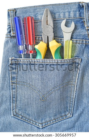 tools in a jeans pocket. Close up. - stock photo