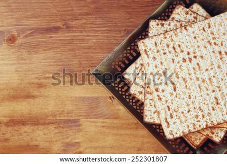 Top view of passover background. matzoh (jewish passover bread) over wooden background. - stock photo