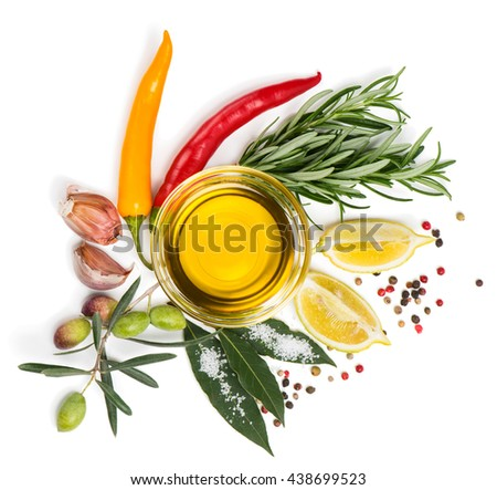Top view of  spices  (chili peppers, bay leaf, rosemary, garlic, and mixture of peppers) and olive oil, lemon  isolated on a white background. - stock photo