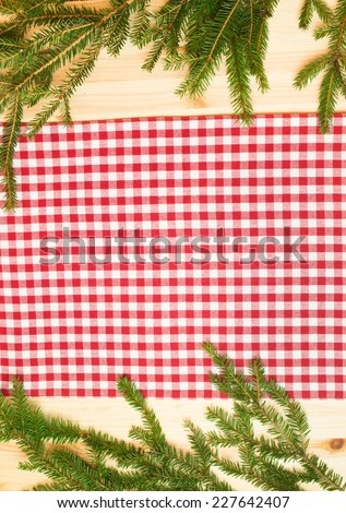 towel  on wooden background with spruce branches - stock photo
