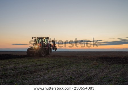 Tractor plowing - stock photo