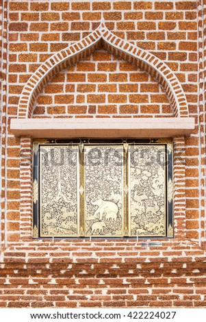 Traditional Ancient Thai style Gold painting window with Brick wall - stock photo