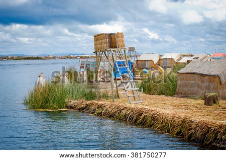 Traditional village on floating Uros  islands on lake Titicaca in Peru, South America  - stock photo