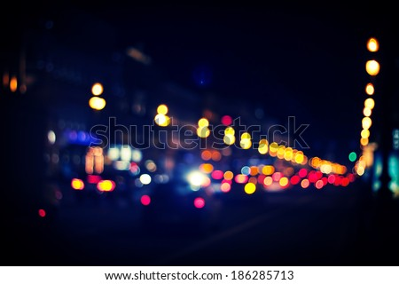Traffic lights of the night city road. - stock photo
