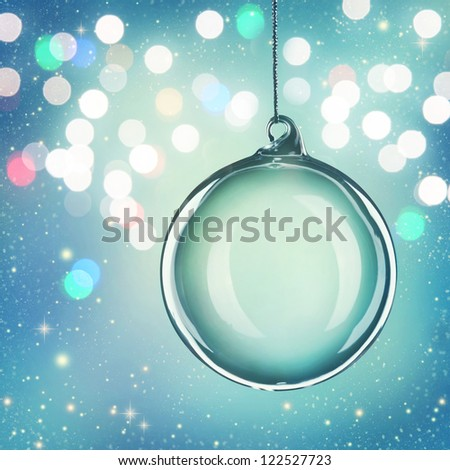 Transparent christmas ball on abstract blue background - stock photo