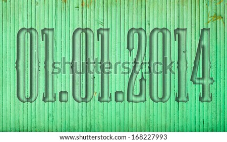 01.01.2014 transparent embossed on wooden background - stock photo