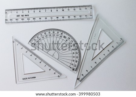 transparent rulers isolated on white background- geometry - stock photo
