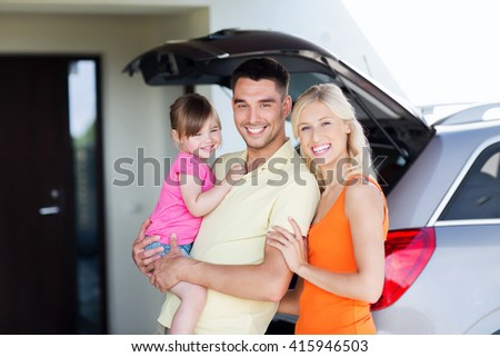 transport, leisure, road trip and people concept - happy family and little girl with hatchback car at home parking space - stock photo